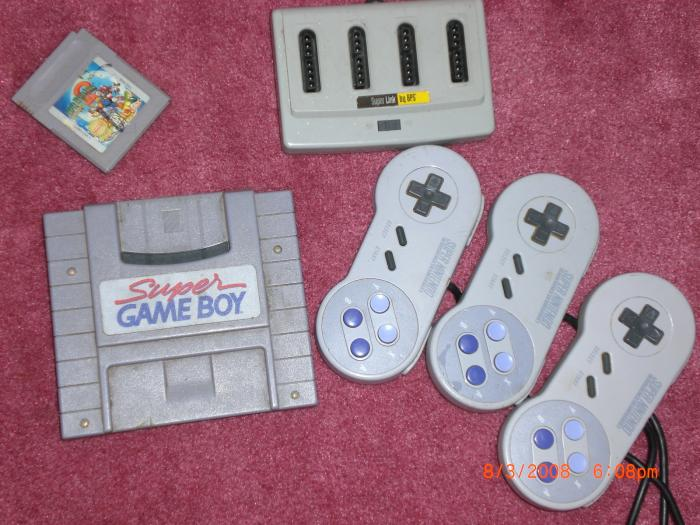 Top: Super Mario Land 3 (Gameboy), Super Link by BPS Bottom: Super Game Boy, (3x) Super NES Controllers
