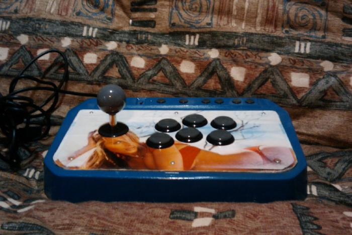My 1st arcade stick.    A Hori Fight Stick 3 I modded with OBSF-30.  I wanted to play with it and the print shop was closed, so I just taped a pic from an old calendar on a piece of cheerios box on the metal plate.  The edges are taped so it wouldn