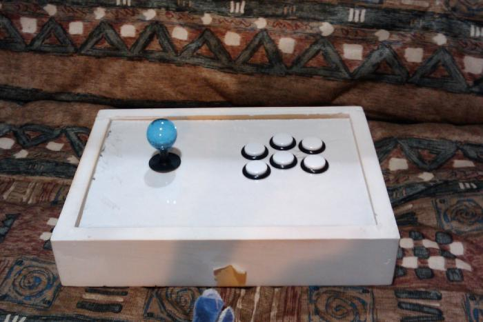 My 2nd arcade stick.  Still a work in progress.  LS-33, PS-14-GN (face buttons), PS-14-DN (home/start select).  PS3 Cthulhu (not wired right now).  Box is custom built by me.  Right now it is only primed.  I wanted to play with it right away so never go