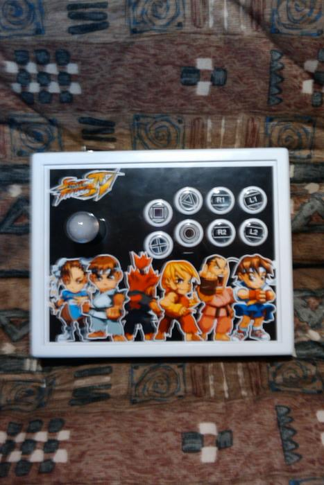 My 3rd arcade stick.    LS-32, PS-14-GN (face buttons), PS-14-DN (home/start/select).  ShinJN AXISdapter.  Case is from sillypuddy on SRK forums.  Great guy, highly recommend buying from him.  Parts (besides AXISdapter) came from infamouskid on SRK foru