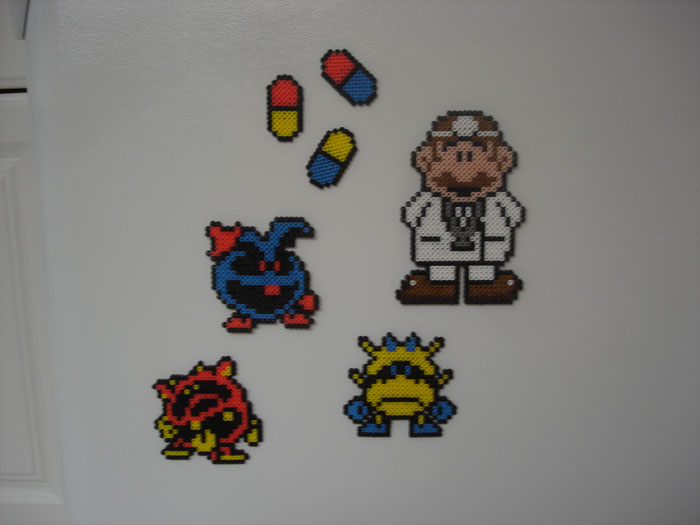Dr Mario (set). Dr. Mario, Pills, Blue Virus, Red Virus, and Yellow Virus.