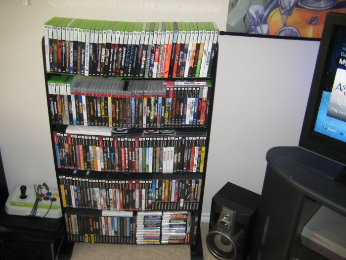 Over to the left of the TV is the DVD game shelf - I need to buy a new bookshelf, I've completely run out of room in this little cheapo DVD shelf!
