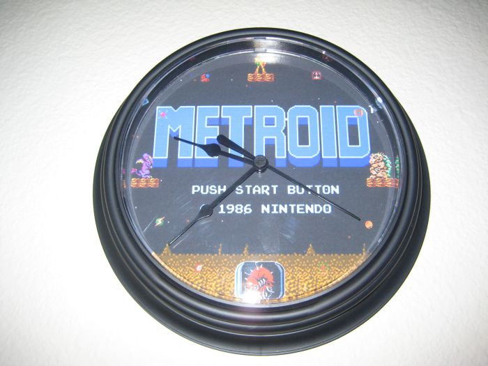 Above the DVD shelf is the newest addition to the game room, a FREAKIN SWEET Metroid clock I got for Christmas.