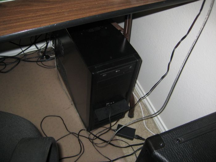 Hey look a non-descript computer case!  It's a dual-core 2.8 Ghz, with a Radeon 4850 and 4GB of ram in it.  Mainly it's my Media Center/File Server, but it plays games decently.  Built it mid 2009 for about 600.