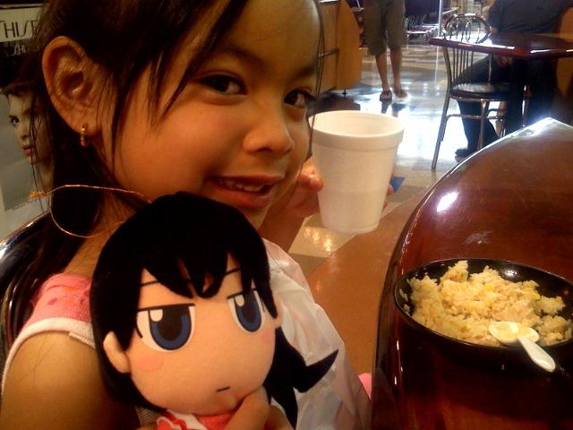 Kailee at Mitsuwa with her Azumanga Daioh plushie.