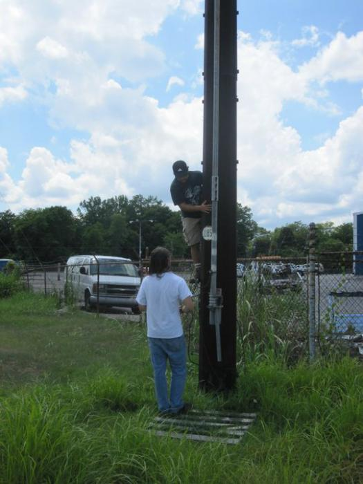 Looking up a utility pole for a geocache. Then in an aquaduct. Police were called.