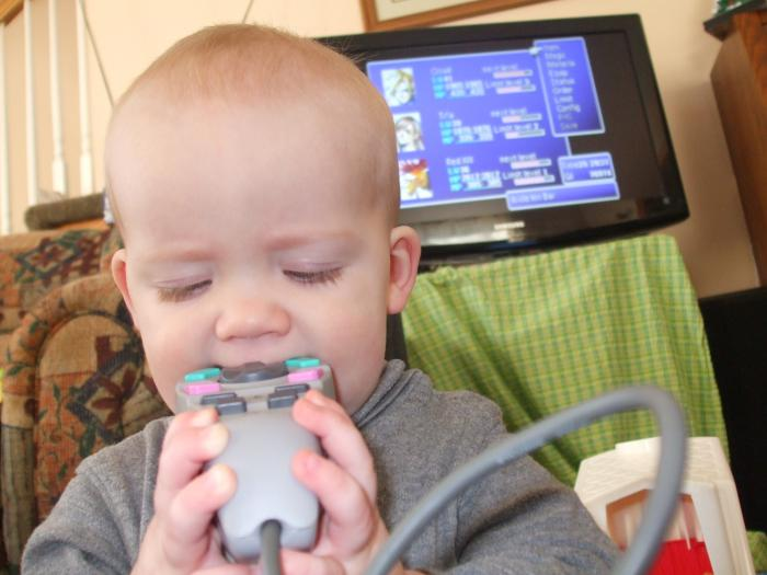 Helping dad play FFVII with the 1 handed controller at 10 mos old