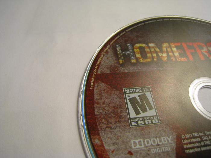 Chipped Homefront PS3 Used Gamefly Disc 003 on the left