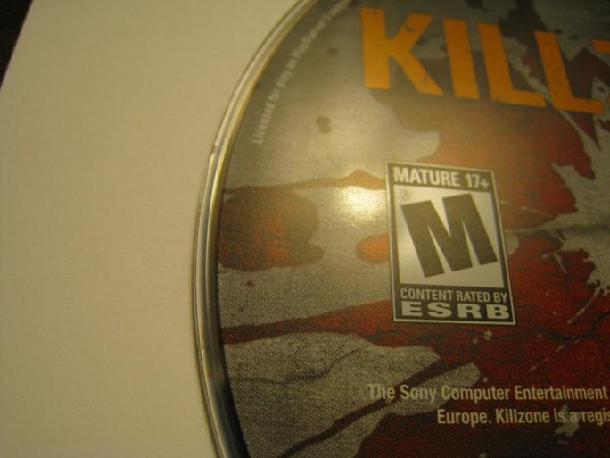 2 chips on Killzone 3 (one to the left of the letter E at the edge of the disc, the other is very visible in the upper left of the picture).