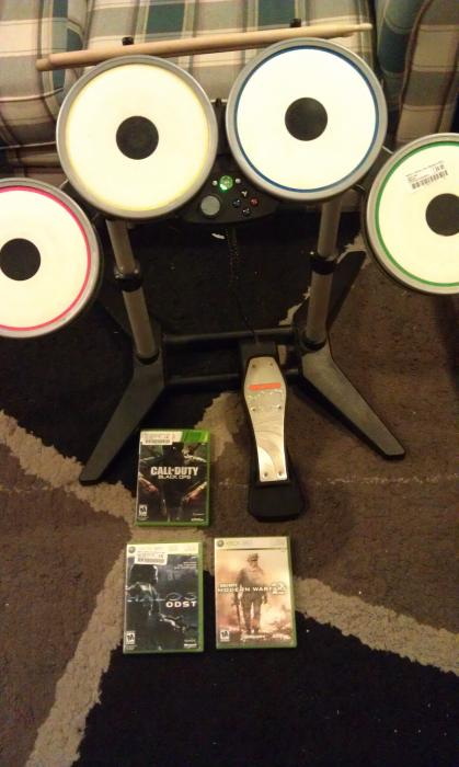 From a local store. $25 for the drums, Black Ops and ODST $5, and MW2 was free in a short.